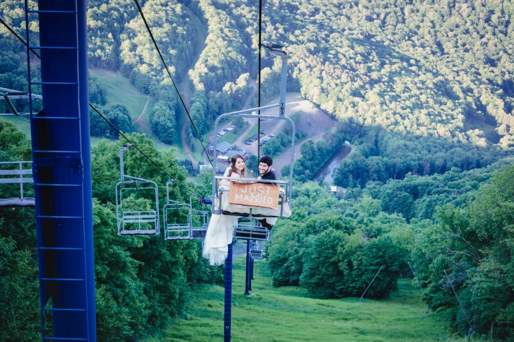 ski lift ride following mountaintop wedding